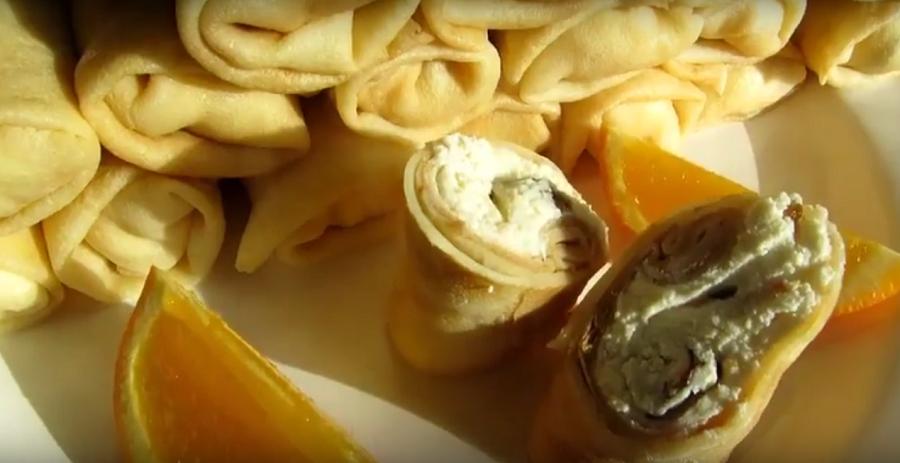 Восхитительные блины с начинкой из творога, изюма и апельсиновой цедры